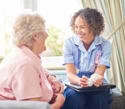 Image of a nurse talking to an elderly lady